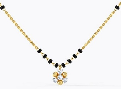 Clover leaf inspired gold and diamond mangalsutra locket